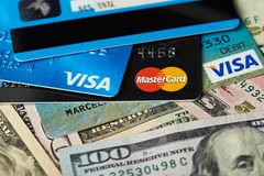 Close-up of visa and master card. New york, USA - August 24, 2017: Close-up of visa and master card lay on dollar money background Stock Photo