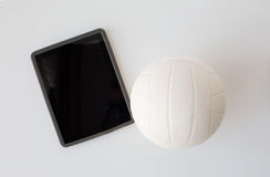 Close up of volleyball ball and tablet pc computer Royalty Free Stock Photo