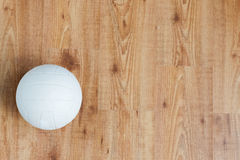 Close up of volleyball ball on wooden floor Stock Photo