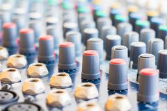 Close up Volume adjusting knobs on audio mixer controller in control room.  stock photos