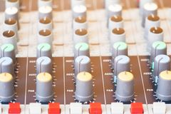 Close up Volume adjusting knobs on audio mixer controller in control room.  royalty free stock images