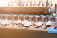 Close up Volume adjusting knobs old on audio mixer controller in control room.  stock image