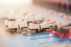 Close up Volume adjusting knobs old on audio mixer controller in control room.  royalty free stock photography