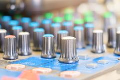 Close up Volume adjusting knobs old on audio mixer controller in control room.  royalty free stock image