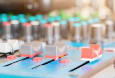 Close up Volume adjusting knobs old on audio mixer controller in control room.  royalty free stock photos