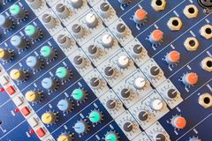 Close up Volume adjusting knobs old on audio mixer controller in control room.  stock images