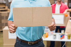 Close up of volunteer showing a poster Royalty Free Stock Photo