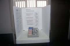 Close-up of a voting booth and ballot machine with ballot , CA Stock Photo