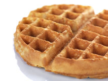 A close up of a waffle. A freshly baked waffle ready for serving in a white background royalty free stock images