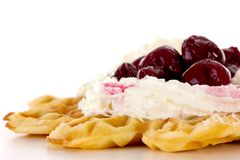 Close-up of waffle with whipped cream and cherries Royalty Free Stock Images