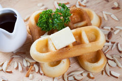 Close-up waffles and nut with parsley and cheese on top. Of waffles on wood plate for breakfast Stock Image