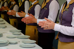 Close-up of waiters clapping hands Royalty Free Stock Photo