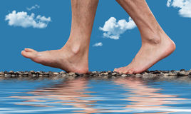 Close up of walking feet. Near water Royalty Free Stock Image