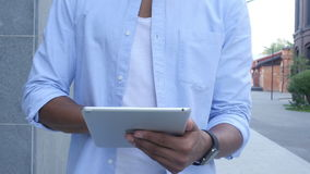 Close Up of Walking Man and Using Tablet for Browsing. Outdoor, Creative designer , businessman stock video