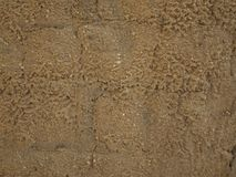 Old eroded adobe wall. Close up of a wall of adobe bricks eroded by rain water Stock Photos