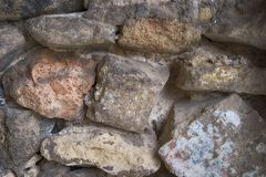 A wall comprised of large rocks and stones. A close up of a wall comprised of large rocks and stones royalty free stock images