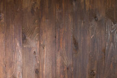 Close up of wall made of dark wooden planks stock images