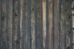 Close up of wall made of wooden planks. Wooden planks painted in dark brown stain cracked in the sun Royalty Free Stock Photography