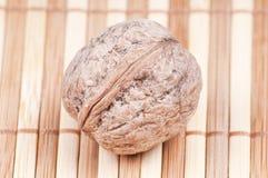 Close up Walnut. On bamboo background Royalty Free Stock Images
