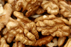 Close-up of walnuts. Selective focus on foreground Stock Photography
