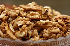 Close-up of walnuts in a glass bowl. Selective focus on foreground Stock Photo