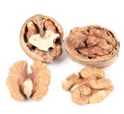 Close up of walnuts and kernels. Royalty Free Stock Photography