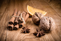 Close up of walnuts, orange and spices Royalty Free Stock Images