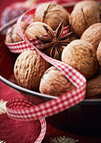 Close up of walnuts and star anise in a bowl Royalty Free Stock Photography