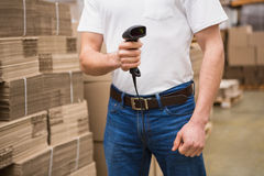 Close up of warehouse worker holding scanner Royalty Free Stock Image