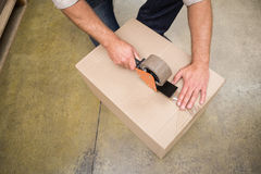 Close up of warehouse worker preparing a shipment. In a large warehouse Stock Photo