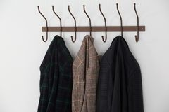 Close-up of warm clothes hanging on hook Royalty Free Stock Photography