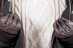 Close-up of warm jumper with jacket and gloves Stock Images