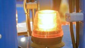 Close up of warning orange beacon flashing