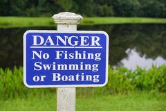 Close up of a warning sign in front of a pond Stock Photo