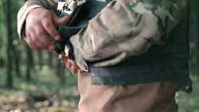 Close up of warrior wears body armor in the forest stock footage
