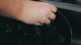 Close up of washing gravel from a pan stock footage