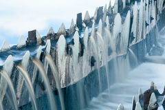 Close-up of waste water overflowing from round settlers Royalty Free Stock Photography