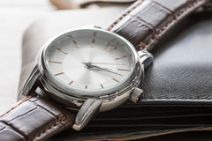 Close up watch and wallet Stock Image