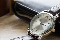 Close up watch and wallet Royalty Free Stock Photography