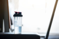 Close up of a water bottle standing near the window Royalty Free Stock Images