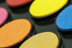 Close up of Water color paints Stock Images