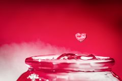 Heart shape water drop. Save and love water concept. Heart shape water drop and ripple. Love and environmental conservation water concept royalty free stock images