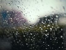 Close-up of water drop on mirror with bokeh background. royalty free stock photo