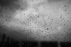 Close up water drop of raining on a window,water drop texture background.  Royalty Free Stock Image