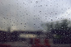 Close up water drop of raining on a window,water drop texture background.  Stock Photos