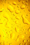 Close up of water drops. On yellow  background Stock Photography