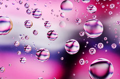 Close-up on water drops background on black,pink and white surfa. Ce. Water droplets with reflections in them Stock Photo