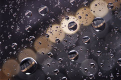 Close-up on water drops background on creamy and black surface. Stock Photo