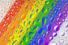 Close up of a water drops. On a multicolored rainbow gradient background, covered with drops of water -condensation stock photography