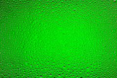 Close up of a water drops. On a green gradient background, covered with drops of water -condensation Stock Photo